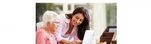 WOman helping older lady work on her laptop
